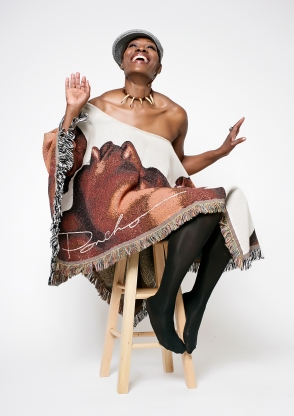 Photo by Beverli Alford. Poncho Creator, Renown Artist/Wearable Arts Designer Larry Poncho Brown www.theartofPoncho.com. Make up by Theron.